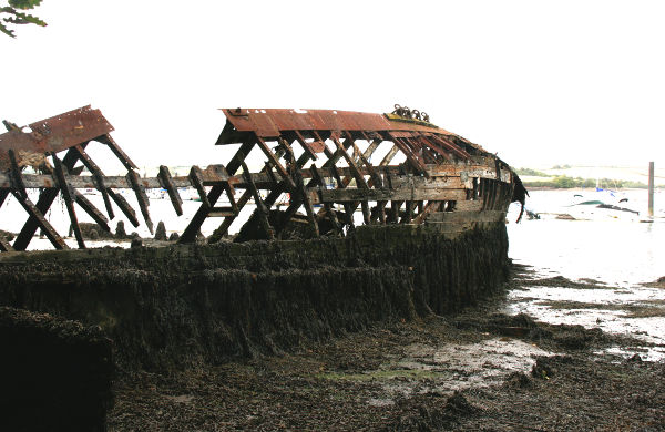 A wreck on a rocky beach