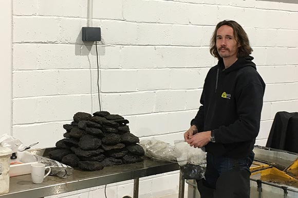 Thumbnail - Dan Pascoe, the site archaeologist, with a pile of wadding
